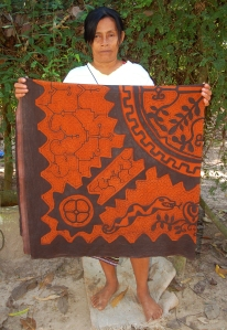 Shipibo artisan Esther Lopez Chavez with hand-made fabric. Photo by Campbell Plowden/Center for Amazon Community Ecology