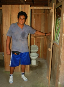 Exiles from Rainforest Conservation Fund at new bathroom in Chino. Photo by Campbell Plowden/Center for Amazon Community Ecology