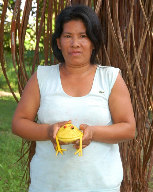 Lastemia Ruiz with woven frog. Photo by Campbell Plowden/Center for Amazon Community Ecology