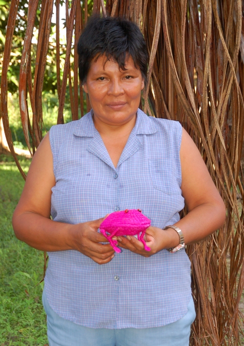 Liria Enocaires with woven frog. Photo by Campbell Plowden/Center for Amazon Community Ecology
