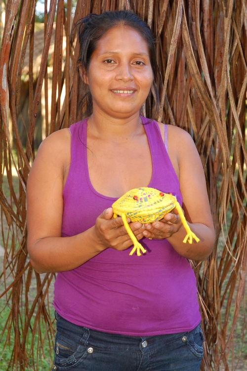 Madita Sinarahua with woven frog. Photo by Campbell Plowden/Center for Amazon Community Ecology
