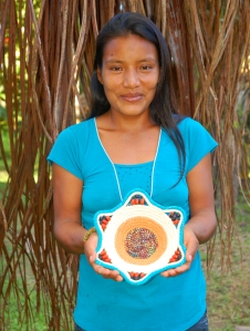 Melodi Tuesta with woven bowl. Photo by Campbell Plowden/Center for Amazon Community Ecology