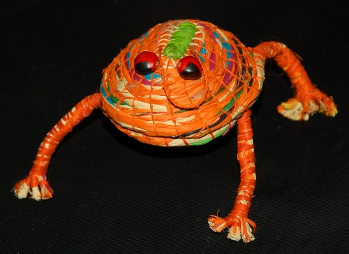 Orange woven frog ornament made by artisan from Chino, Peru. Photo by Campbell Plowden/Center for Amazon Community Ecology