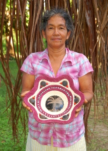 Romelia Huanaquiri with woven bowl. Photo by Campbell Plowden/Center for Amazon Community Ecology