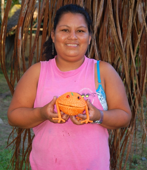 Rosa Sanchez with orange frog. Photo by Campbell Plowden/Center for Amazon Community Ecology