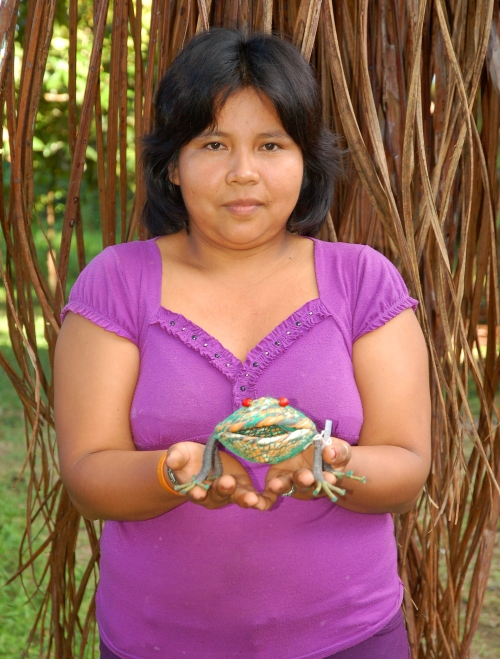 Sarita Mendoza with woven frog. Photo by Campbell Plowden/Center for Amazon Community Ecology