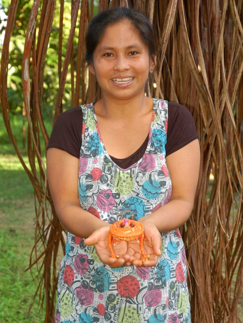 Yermeth Torres with orange frog. Photo by Campbell Plowden/Center for Amazon Community Ecology