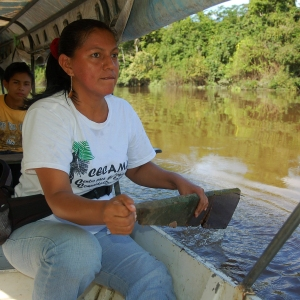 Yully Rojas paddling RCF boat with floorboard in 2010. Photo by Campbell Plowden/Center for Amazon Community Ecology