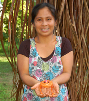 Yermeth Torres with woven frog at Chino. Photo by Campbell Plowden/Center for Amazon Community Ecology