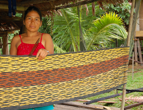 Bora artisan from Brillo Nuevo with woven chambira fiber hammock dyed with guisador root and other plants. Photo by Campbell Plowden/Center for Amazon Community Ecology