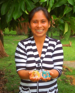 Yermeth Torres with frog ornaments. Photo by Campbell Plowden/Center for Amazon Community Ecology