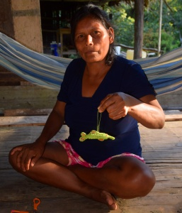 Maijuna artisan Elena and dolphin ornament. Photo by Campbell Plowden/Center for Amazon Community Ecology