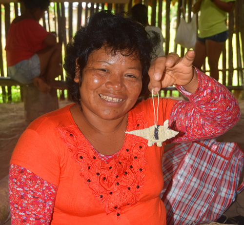 Bora artisan Ines C with her woven armadillo ornament.. Photo by Campbell Plowden / Center for Amazon Community Ecology
