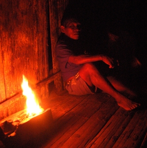 Maijuna elder sleeping next to copal flame. Photo by Campbell Plowden/Center for Amazon Community Ecology