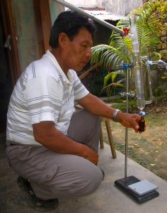 Shebaco observing copal distillation in Iquitos. Photo by Campbell Plowden/Center for Amazon Community Ecology