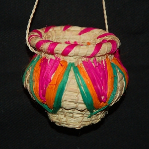 Miniature woven pot ornament made by mestizo artisan Dora Tangoa in cooperation with the Center for Amazon Community Ecology. Photo by Campbell Plowden/CACE
