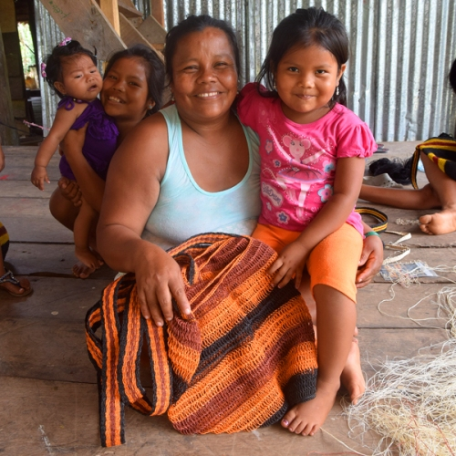 Bora artisan with daughters and woven bag in Puca Urquillo. Photo by Campbell Plowden/CACE
