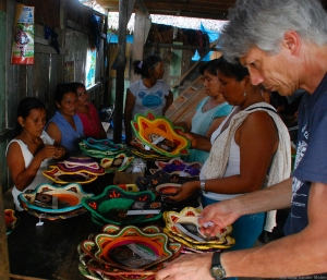 Campbell inspecting chambira baskets in Chino. Photo by Matt VanderMolen/CACE