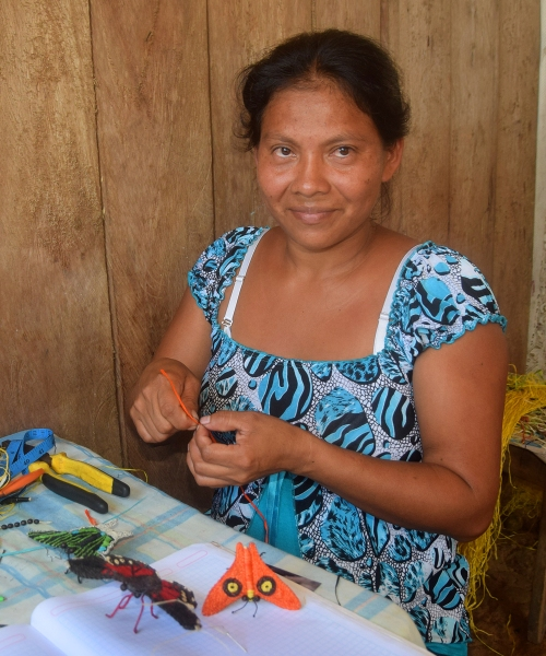 Artisan Doilith del Castillo from Jenaro Herrera with butterfly ornaments. Photo by Campbell Plowden/Center for Amazon Community Ecology
