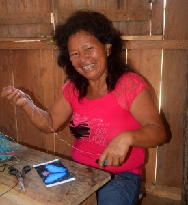Hilda weaving blue morpho butterfly ornament. Photo by Campbell Plowden/Center for Amazon Community Ecology