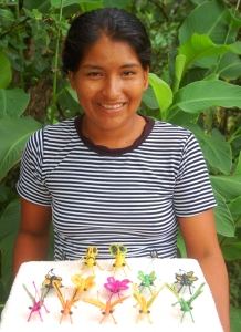 Artisan Rosa Mozombite from Jenaro Herrera with chambira insect ornaments. Photo by Campbell Plowden/Center for Amazon Community Ecology